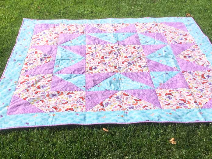 A perfect picnic quilt is made of a simple quilt design