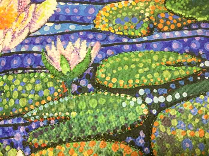 The lily pads on the Artisan Spirit Water Garden panel have been outline quilted with green Sulky rayon thread   SULKY / SCHMETZ / Northcott
