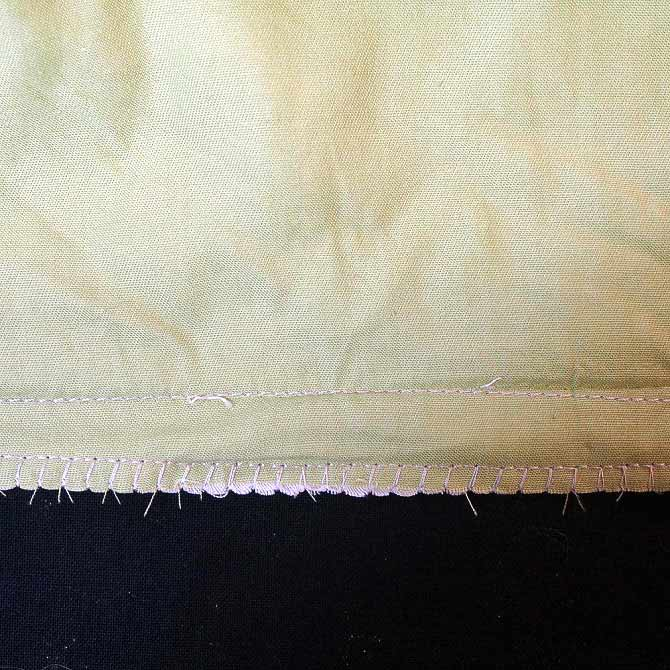 Overlocking stitch used to secure edge of fabric