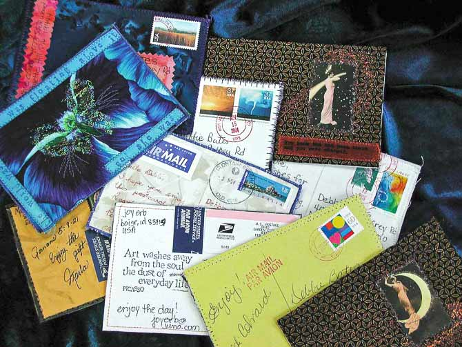 Quilted postcards, also called artist trading cards, can become quite a cherished collection. It reminds us of our 'textile' or 'quilting' friends and satisfies that fabric obsession we have - right?