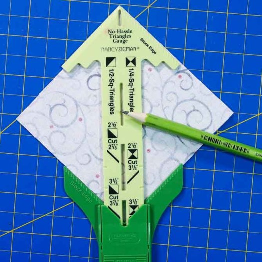 Fabric under gauge ready for pencil line