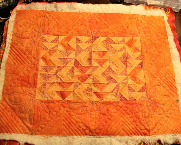 The border for the Persevere Walhanging was quilted with Accent and Fruitti threads.