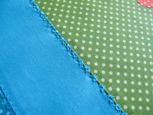 The snowflake/floral stitch now embellishes the complete length of this seam
