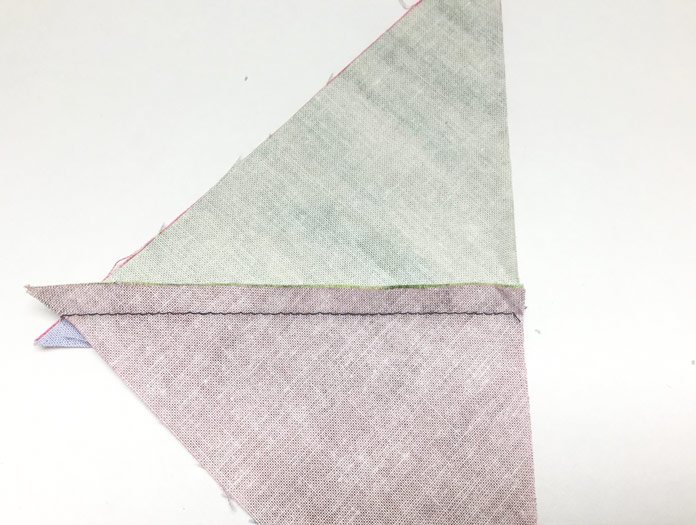 Sew all of the pieced triangle sets together in pairs matching the seam in the center.    A tutorial on thread painting using SCHMETZ needles/ Gütermann threads / Northcott fabric