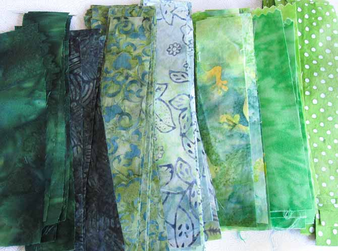 stacks of green batik strips