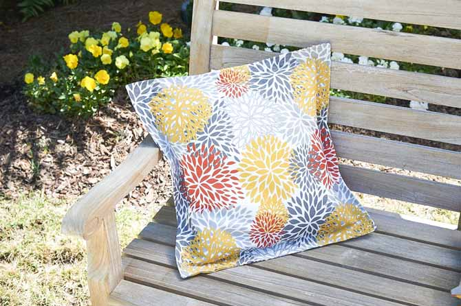 a Knife Edge Cushion Cover on a patio bench using Coats Outdoor Threads