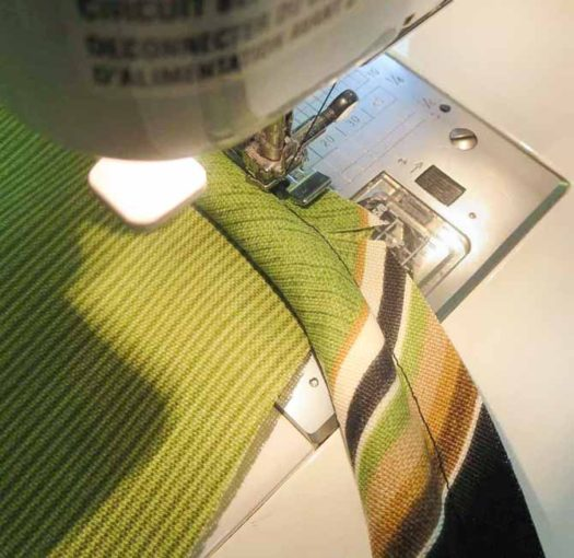 Make a diagonal cut in seam allowance of the cording.
