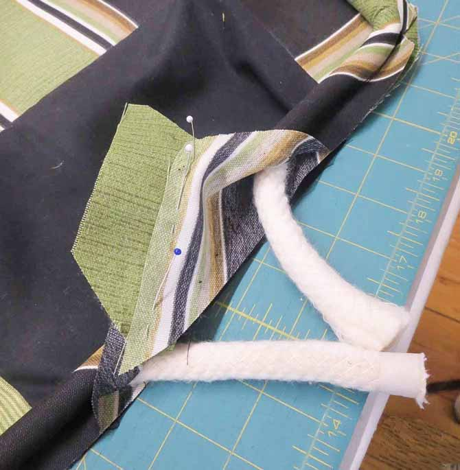 Stitch the ends of the cording fabric together.