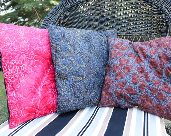 Pillows quilted with WonderFil's Fruitti #13 Hibiscus, Accent # 2121 Dark Gold and Spagetti #05 Turquoise