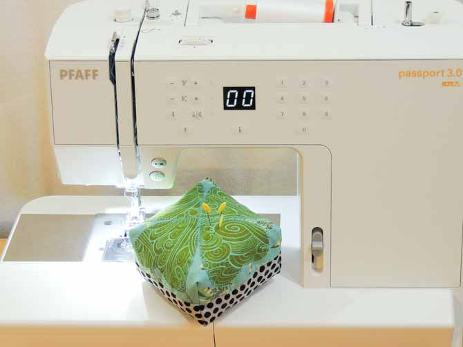 A lucky pincushion is easy to make by adding an applique four leaf clover to your fabric with the PFAFF passport 3.0