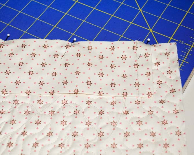 Step #6 - Center the hanging sleeve on the top back of the wallhanging with the raw edges aligned and pin in place