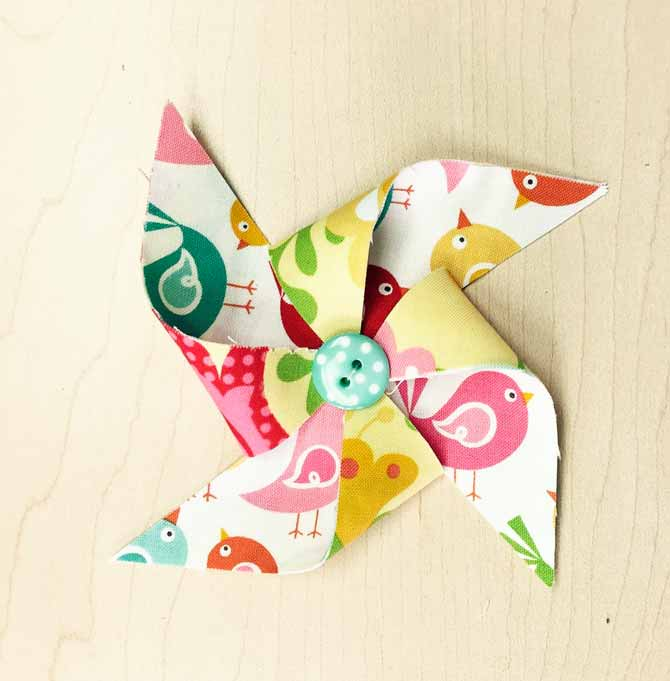 Fabric pinwheel made from fabric squares.