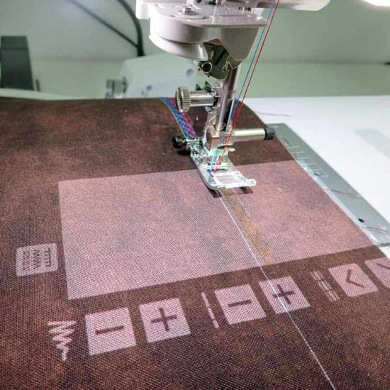 The projector feature shows the decorative stitch exactly how it will look on the fabric.
