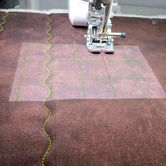 Grid lines help line up stitching and quilting lines.