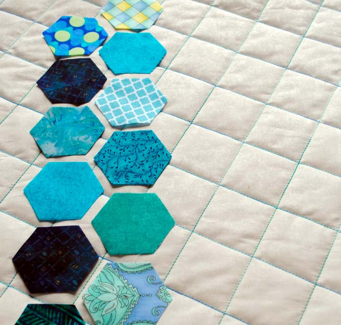 Placement version #3 - hexagons lined up along left side of pillow top.