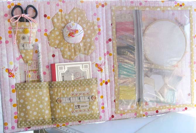 Le voila! A portfolio that offers pretty storage for portable sewing projects.