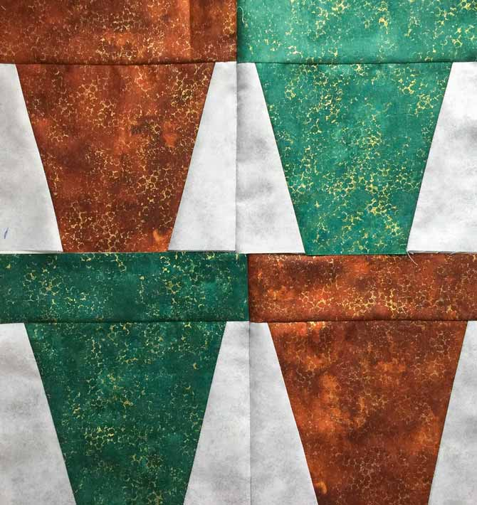 Four flower pot pieced quilt blocks of green and brown, in sets of two. Northcott's Artisan Spirit Shimmer Echoes.