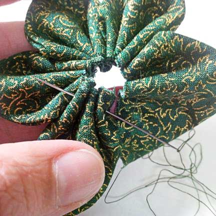 Pull thread through first petal