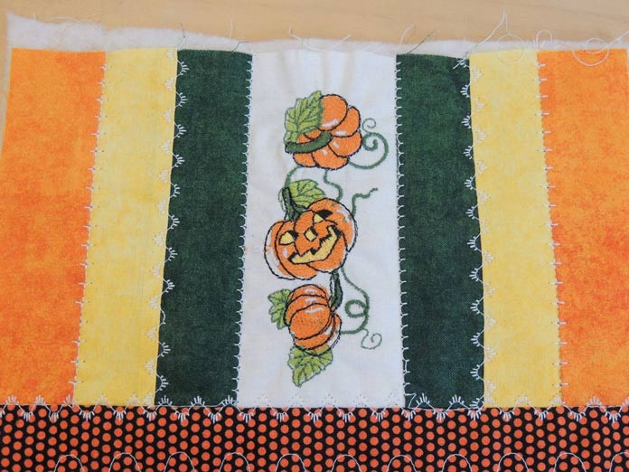 Decorative pumpkin stitch trimmed and sewn into project