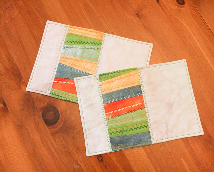 Strip pieced placemats using WonderFil's Pumpkin rayon thread pack.