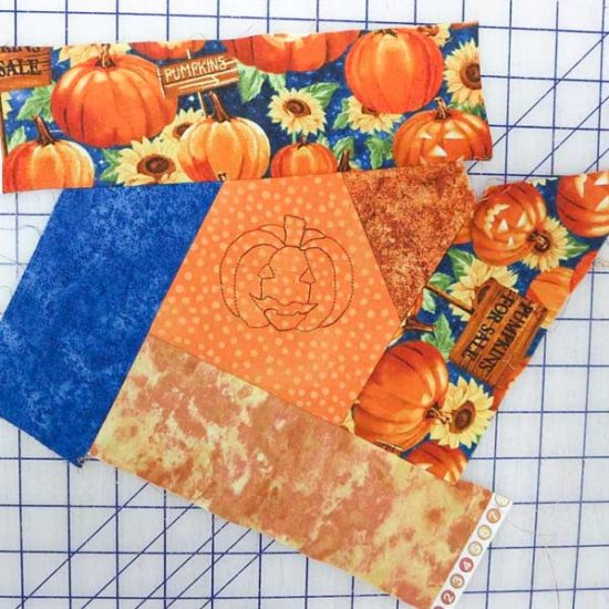 """3"""" strips have been sewn all around the embroidered square."""