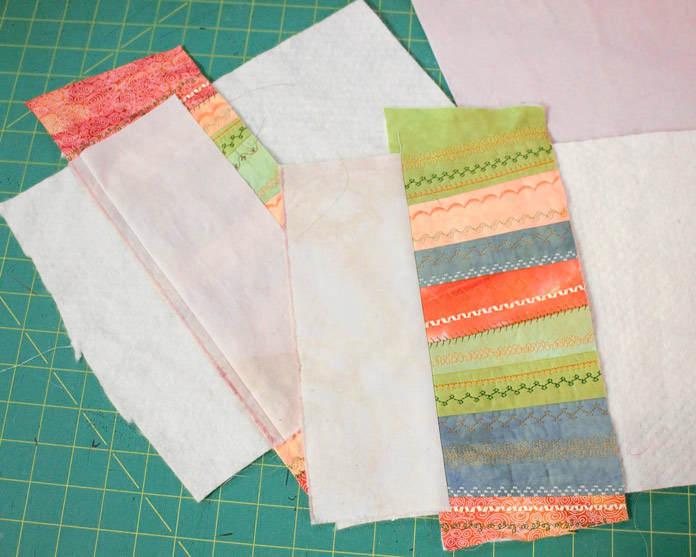 Highlight the decorative strip of fabric with coordinating pieces of fabric using the quilt as you go method.