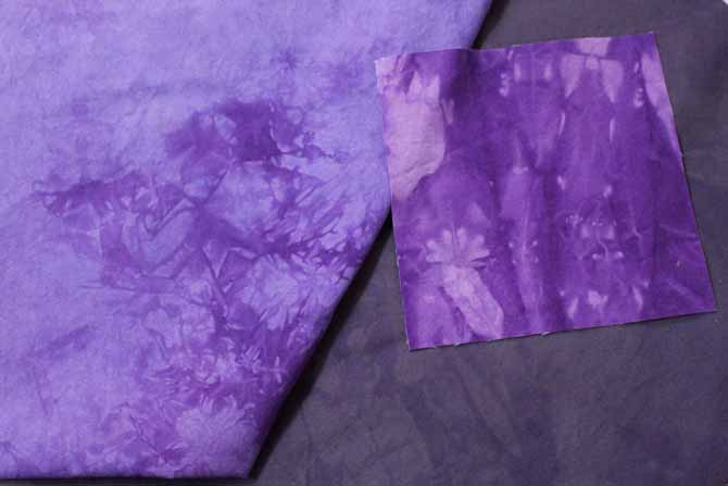 The grey fabric and the larger piece of light purple fabric were over dyed with Intense Violet dye from Dylon Permanent Fabric Dyes.