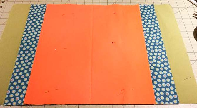 The pocket tubes made with the Northcott fabrics are pinned in place on the artist case cover.