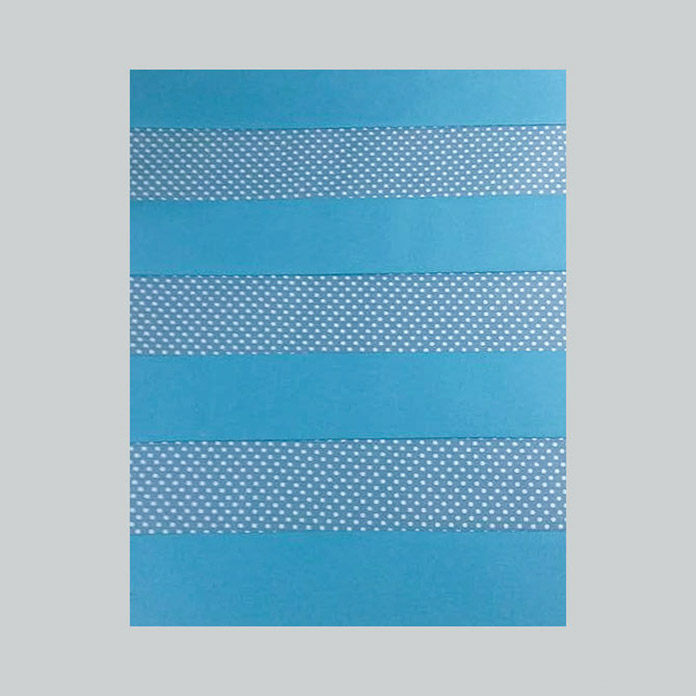 The blue strips stitched together, alternating the fabrics