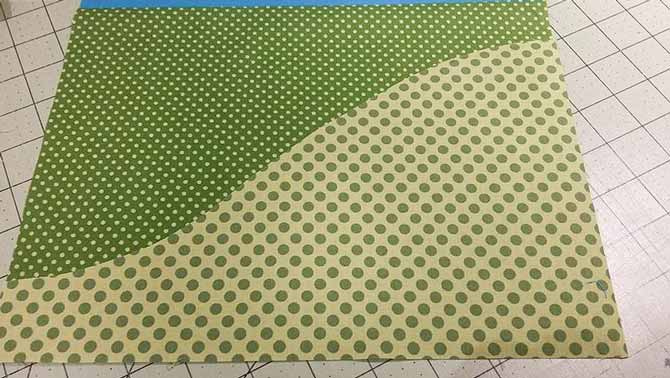 To complete the green ends of our table runner, we're making landscape templates from a second coordinating green print from Northcott Fabrics Urban Elementz Basix Collection.