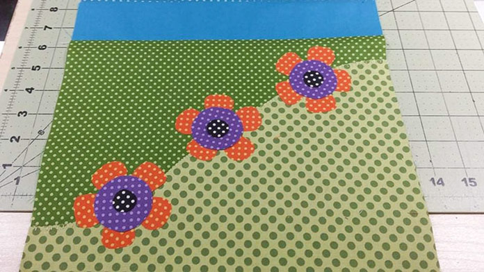 Flower appliques positioned on the end of the table runner