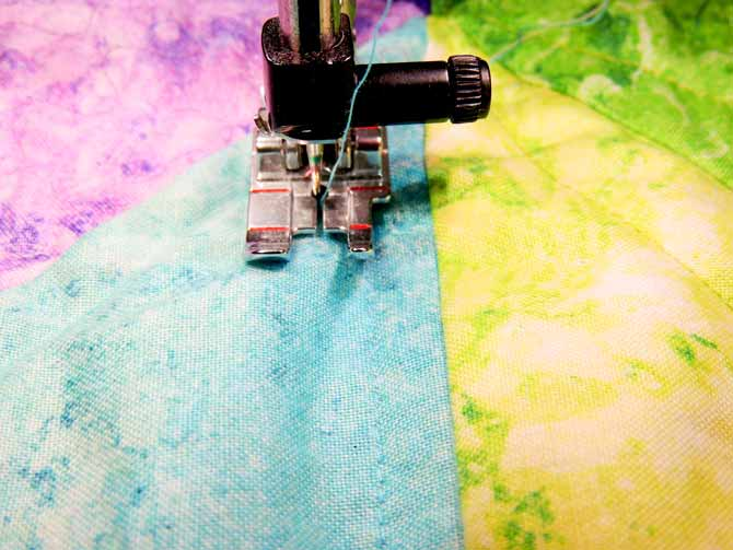 Using ¼ʺ quilting foot as quilting guide