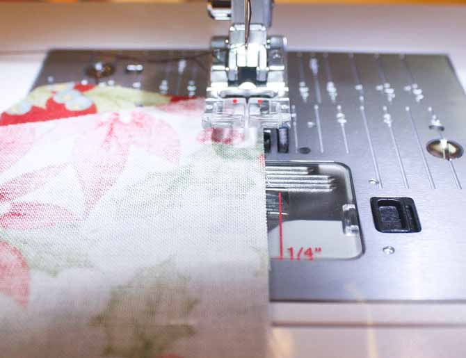 """A 1/4"""" mark on the bobbin plate cover makes it easy to get the perfect 1/4"""" seam"""