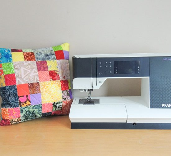 Quilted patchwork cushion and PFAFF quilt expression 720 machine.