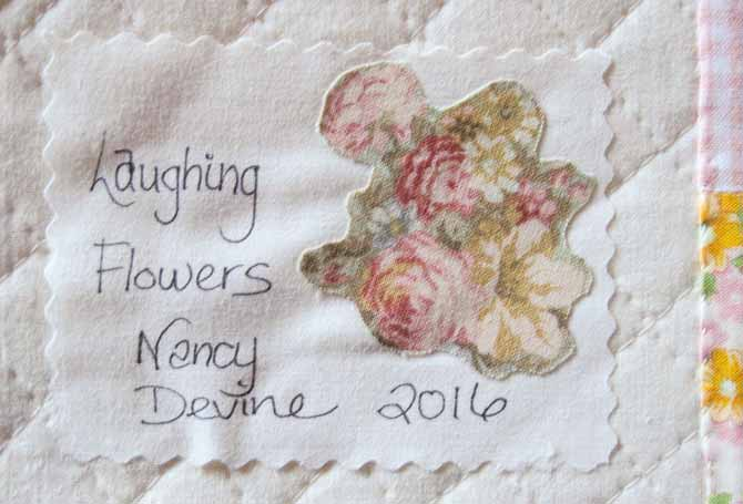 Add a quilt label to your quilt.