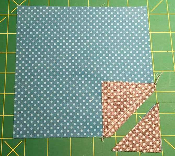 "The excess fabric on the corner is trimmed ¼"" outside of the seam."