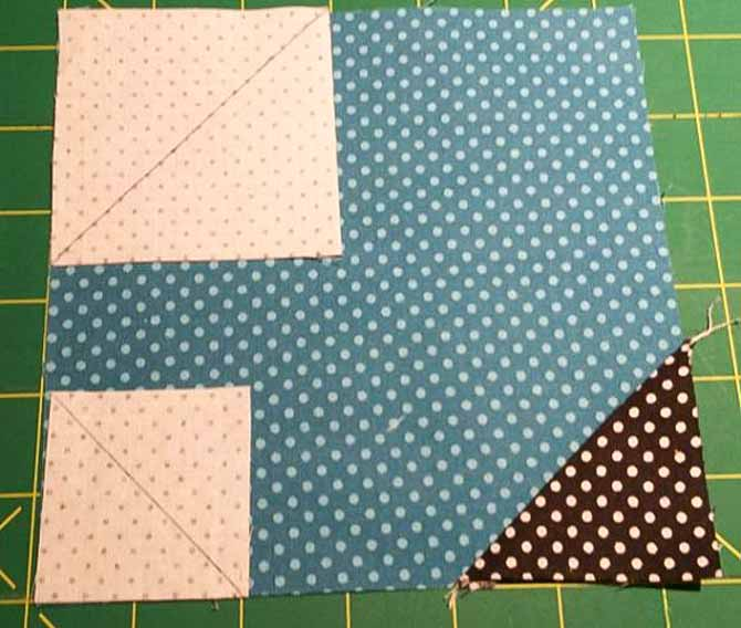 The background squares of Urban Elementz Basix fabric are placed on the flower petal square, right sides together; ready to be stitched on the diagonal lines.