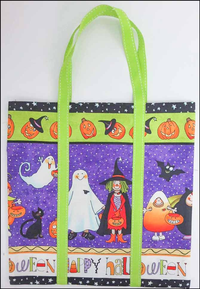 Finished treat bag made with Northcott's Happy Halloween fabric