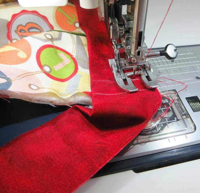 "Use a walking foot to sew on binding using a ½"" seam."
