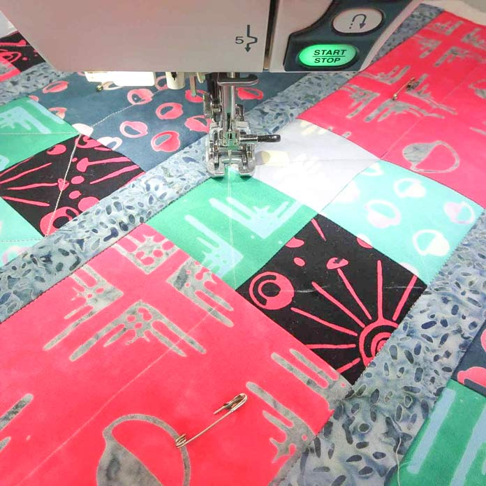 Use a walking foot for quilting.
