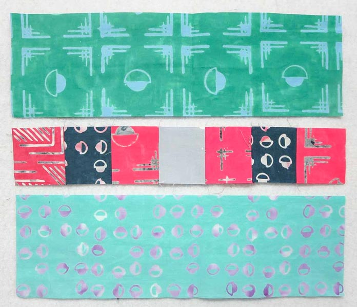 """5"""" strips and 2¾"""" squares ready to be sewn together"""
