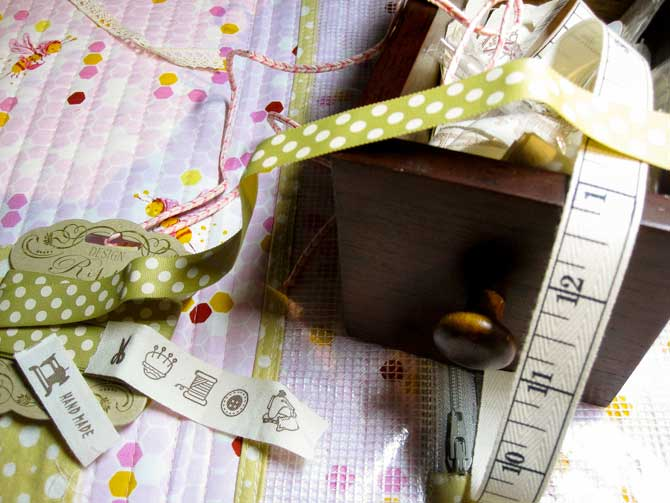 We've raided our stash of pretty and fun ribbons and buttons to make this portfolio.