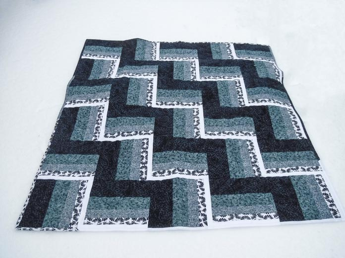 The finished rail fence quilt using Banyan Batiks Banyan Classics Collection - free pattern!