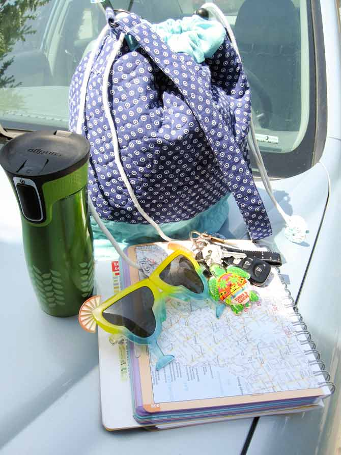 Coffee mug? Check. Fun sunglasses? Check. Road maps? Check? Keys? Check. Cool bucket bag you made yourself? Check and check! See ya later!