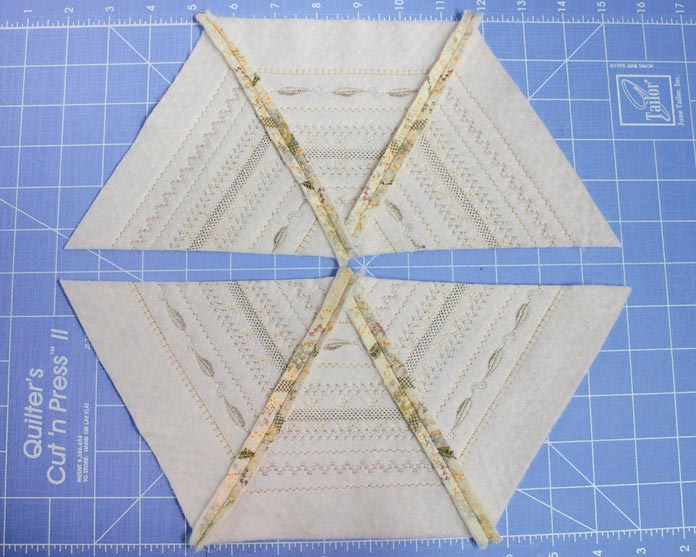 Arrange the triangles and sew into sets of 3.