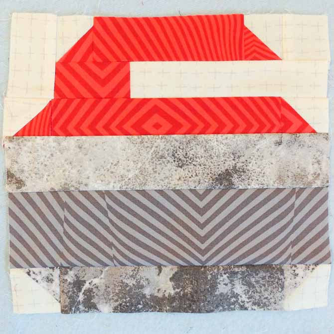 Red Curling Stone Quilt Block