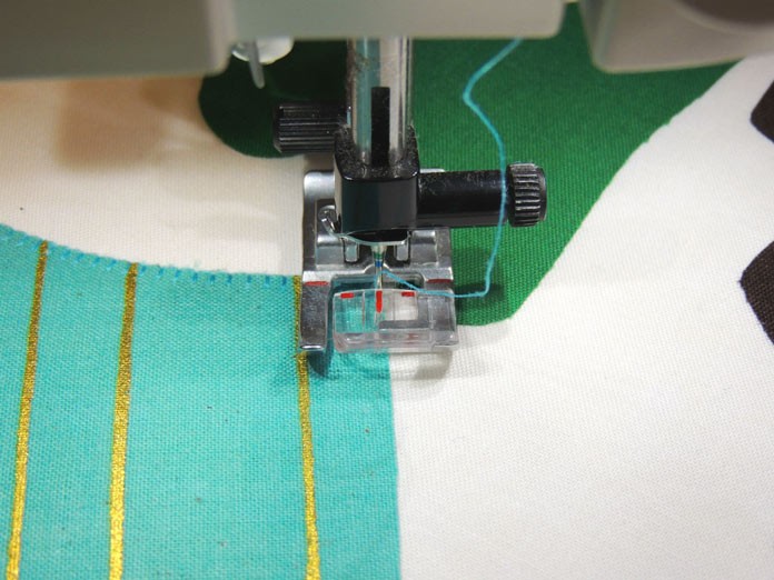 Using presser foot guide-marks to line up stitches.