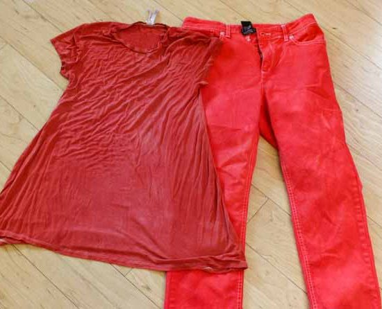 A pair of white jeans and beige t-shirt dyed with Pagoda Red Dylon Multi-Purpose dye.