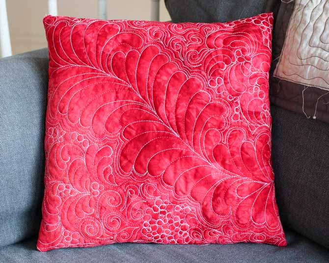 Cushion quilted with WonderFil's Fruitti #13 Hibiscus