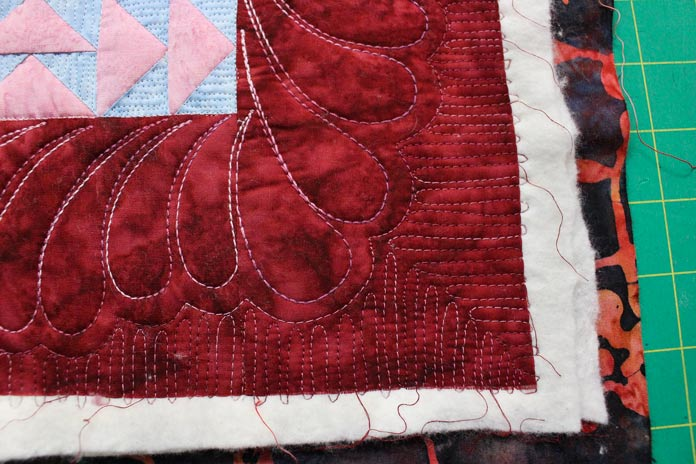 Quilted with WonderFil 50wt Tutti and 12wt Fruitti cotton threads.